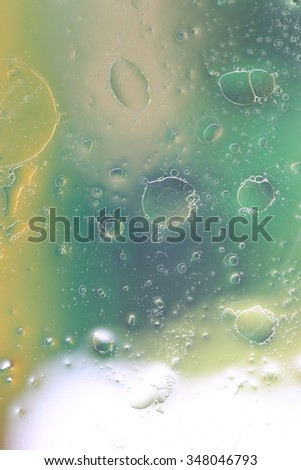 Background of water and oil drops on glass  - stock photo