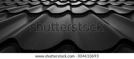 Background of wavy metallic tiles for roofing. - stock photo