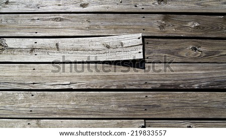 background of weathered boards with one warped - stock photo