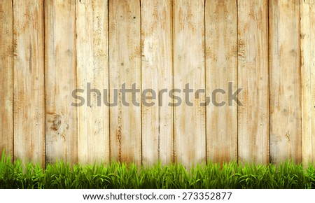 Background of wooden fence and green grass - stock photo