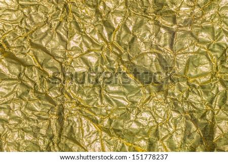 background of wrinkled golden foil  - stock photo