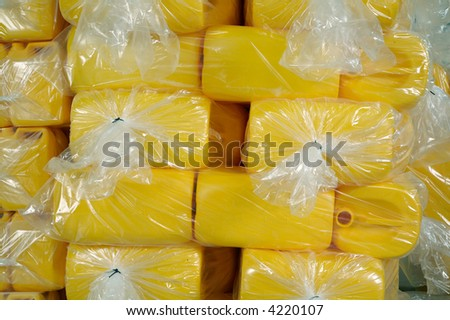 background of yellow plastic containers - stock photo