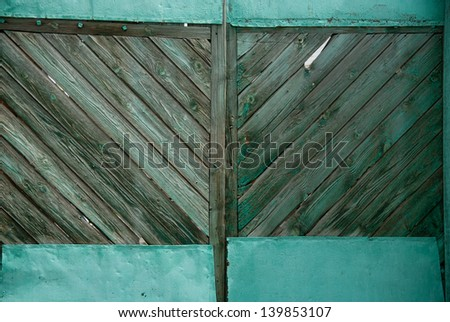 Background old green wooden gate. - stock photo