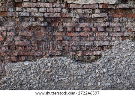 Background old ruined brick wall. Vintage red brick wall. - stock photo