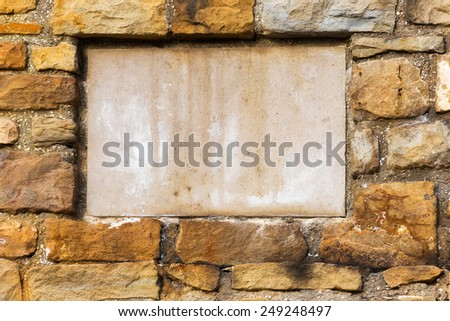 Background old stone wall with a blank marble slab for any inscriptions or bas creative design - stock photo