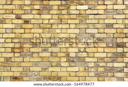 Background on an old yellow brick wall - stock photo