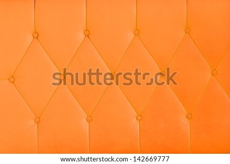 Background orange sofa. - stock photo