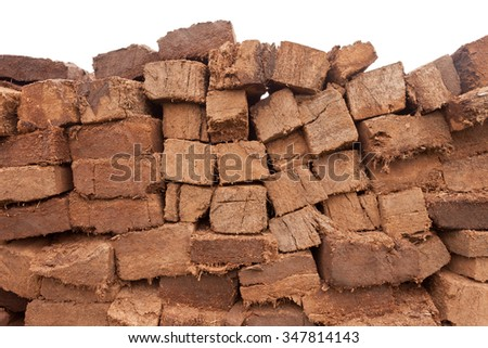 Background pattern abstract of pile of drying stacked bog peat turf briquette cuttings - stock photo