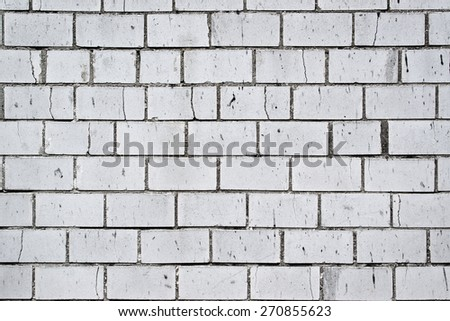 Background pattern of weathered old white brick wall texture, grungy rusty brushed blocks as urban architecture backdrop. - stock photo