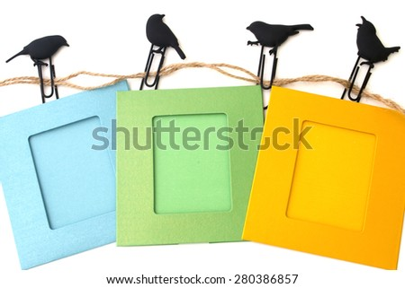 background photo frames with clips isolated on a white birds - stock photo