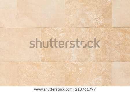 Background photo texture of stone wall with artificial marble tiling - stock photo