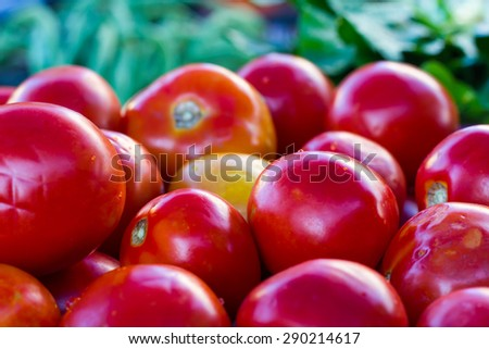 Background pile of beautiful red tomatoes sold in the retail market, Thailand. - stock photo