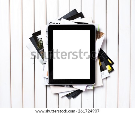 Background. Reading books makes you better - text on a screen of electronic book on top of a pile of books and magazines. Concept of learning new knowledge, self improvement and development of mental - stock photo