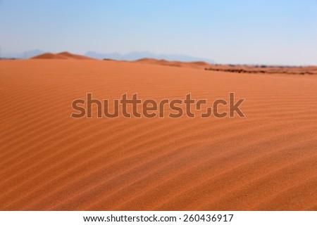Background red desert sand in Dubai at sunset - stock photo