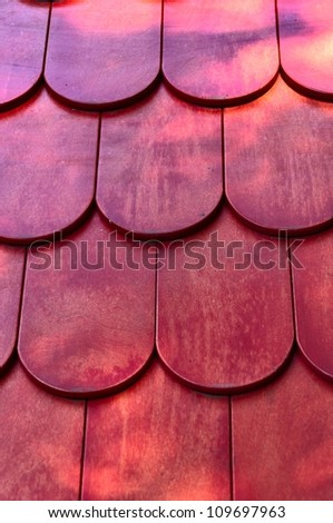 Background - red wooden roof texture, vertical view. - stock photo