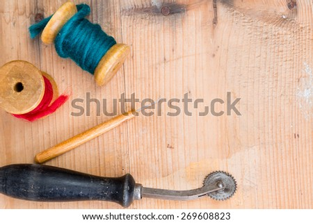 background - sewing accessories on wood  - stock photo