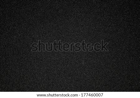 Background shot of black plastic texture - stock photo