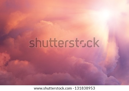 Background  sun coming into pink clouds. - stock photo