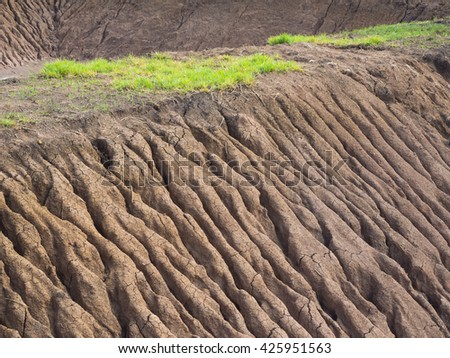 Background texture abstract traces of soil, water, coastal erosion, which has been flowing into the well. - stock photo
