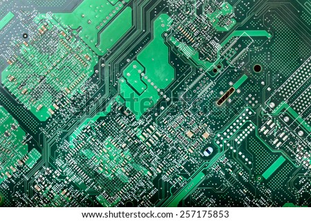 background texture of a circuit board - stock photo