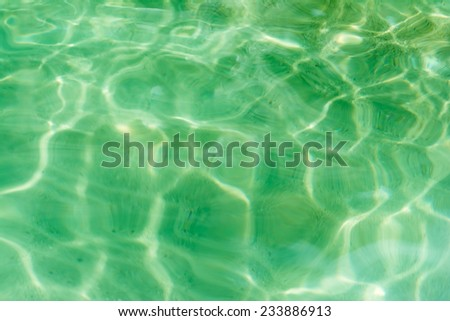 Background texture of a crystal green water in a paradise tropical island in Thailand - stock photo
