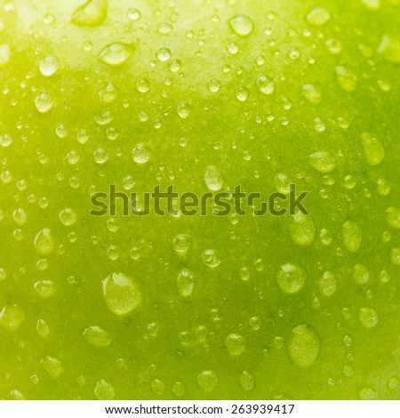 background texture of a green apple with waterdrops - stock photo