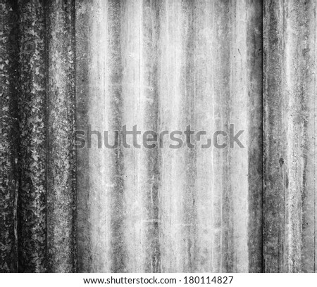Background texture of corrugated iron sheets with rust and wear in black and white - stock photo