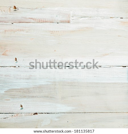Background texture of painted or whitewashed white wooden boards with a mottled brushstroke pattern in square format with copyspace for your text - stock photo
