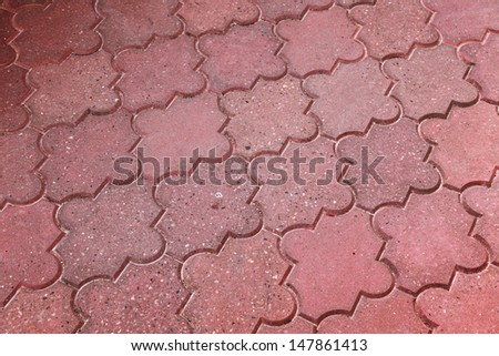 Background texture of red modern cobblestone pavement - stock photo