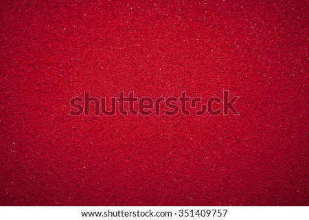 Background texture of solid red color made of soil. - stock photo