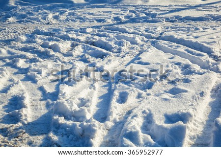background texture of the snow. Footprints in the snow and car - stock photo