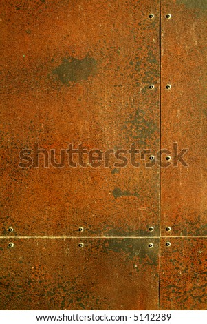 background texture, rusty steel with rivets - stock photo