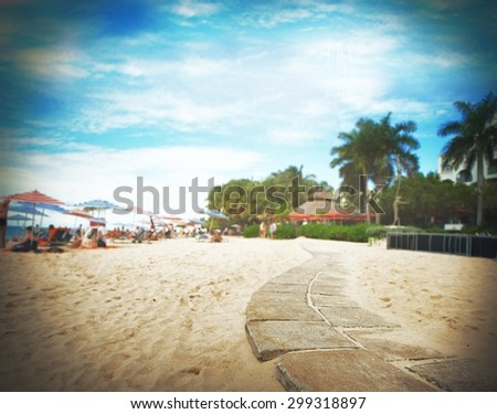 Background tropical beach with umbrellas and chairs - stock photo