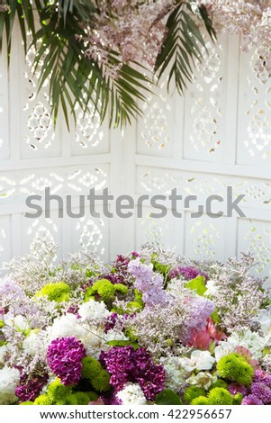 Background wedding lilac flowers close-up. Wedding decoration of natural flowers. - stock photo