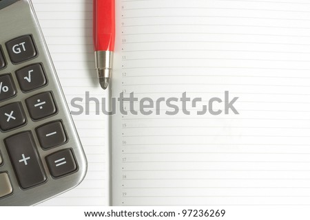 background with a calculator and red pen - stock photo