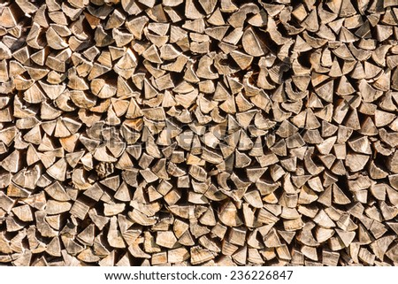 Background with a pile of firewood - stock photo