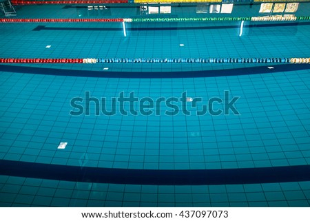 Background with a swimming pool and markers between lanes competition. - stock photo