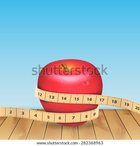 Background with apple and tape measure - stock photo