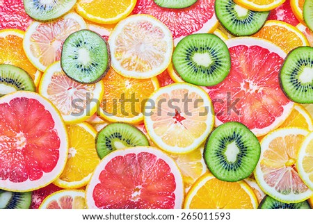 background with citrus-fruit of Fresh fruit slices - stock photo