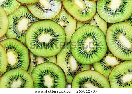 background with citrus-fruit of Kiwi slices - stock photo