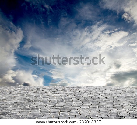 background with cobbled streets and sky - stock photo