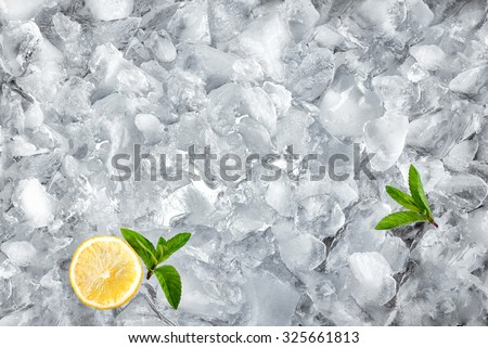 background with crushed ice cubes mint and lemon, top view - stock photo