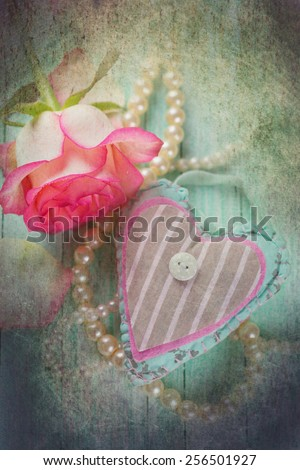 Background with decorative heart and fresh flower. Rose on  wooden table. Selective focus. - stock photo
