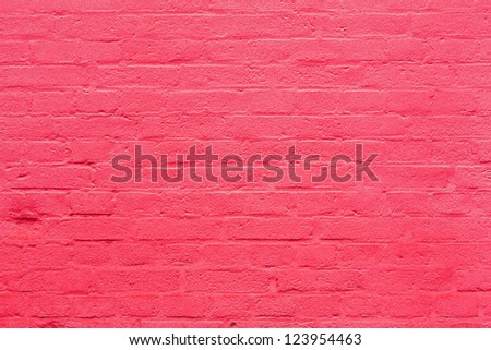 background with fragment of pink brick wall - stock photo