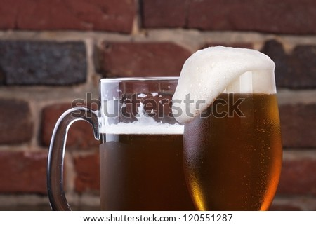 background with Glass of light beer on a dark pub - stock photo