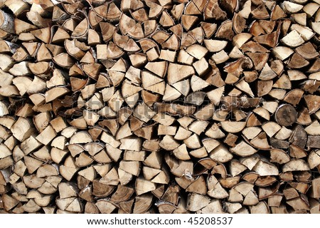 Background with heap of firewood - stock photo
