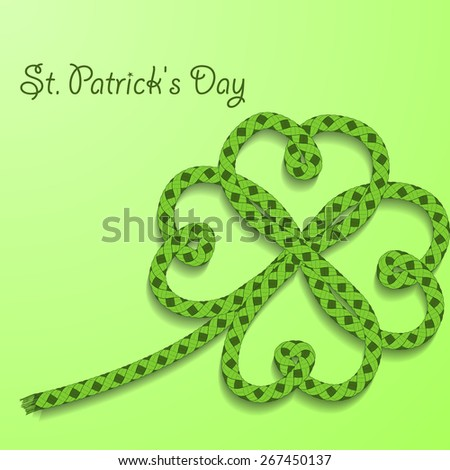 Background with inscription St. Patricks Day. Clover with four petals of green folded rope. Rasterized version. - stock photo