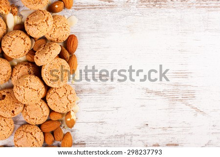 Background with italian almond cookie amaretti and almonds on white vintage table, food concept with copy space, top view. - stock photo