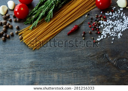Background with Italian food. Ingredients for cooking over dark wooden board (with easy removable sample text). - stock photo