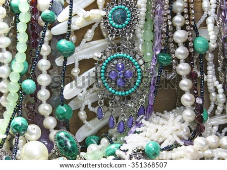 Background with pearl, malachite and other  jewels - stock photo